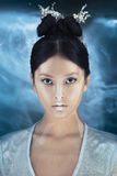 Shot of a futuristic young asian woman. Stock Image