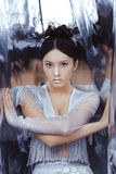 Shot of a futuristic young asian woman. Portrait of futuristic young woman. Reflection of our mind and soul concept. Beautiful young multi-racial asian Royalty Free Stock Images