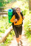 Shot of a girl with a backpack in the woods Royalty Free Stock Images