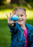 Shot of girl holding Earth in hand Stock Photos