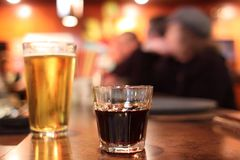 Shot and glass of beer Royalty Free Stock Images