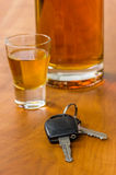 Shot glass with car key Stock Image
