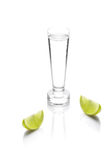 Shot glass filled with clear cold alcohol Royalty Free Stock Image