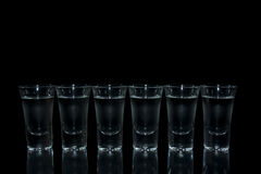 Shot glass with vodka. On black background Royalty Free Stock Photography