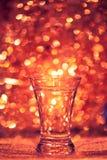 Shot glass of vodka. On shiny festive background Royalty Free Stock Image