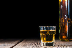 Shot glass with Whiskey Royalty Free Stock Image