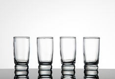 Shot glasses. Silhouette of four shot glasses Stock Photography