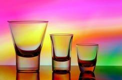 Shot glasses. Three vodka shot glasses with colorful gradient backround Stock Photo