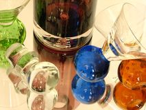 Shot Glasses. Shot of a glass bottle with some shot glasses over a mirror. white back ground Royalty Free Stock Photos