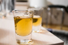 Shot glasses with brandy. Shot glasses with plum brandy Stock Image