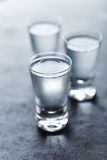 Shot glasses of cold vodka Royalty Free Stock Images