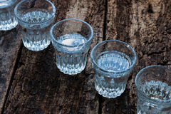 Shot glasses cold vodka top view Stock Photography