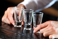 Shot glasses on a counter Stock Image