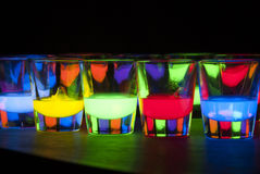 Shot Glasses with Glow Stick Juice Stock Photography