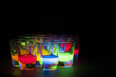 Shot Glasses with Glow Stick Juice. In them Stock Image