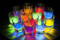Shot Glasses with Glow Stick Juice Stock Photos