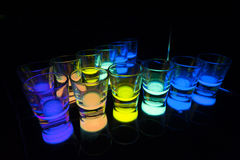 Shot Glasses with Glow Stick Juice Stock Photo