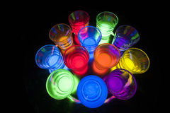 Shot Glasses with Glow Stick Juice Royalty Free Stock Photos
