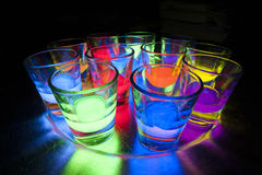 Shot Glasses with Glow Stick Juice Royalty Free Stock Photo
