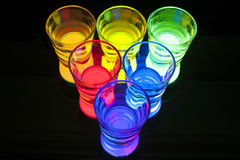Shot Glasses with Glow Stick Juice Stock Images