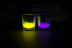 Shot Glasses with Glow Stick Juice Royalty Free Stock Photography