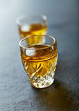 Shot glasses of herbal vodka Stock Image