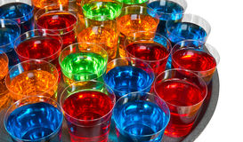 Shot glasses on tray. Various alcoholic shots in shot glasses in a serving tray often used for offers in the drinks industry Stock Photo