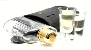 Shot Glasses with Whiskey Alcohol flask and case. On a white background. The flask has a brass cap royalty free stock image