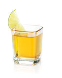 Shot of gold tequila with lime slice Royalty Free Stock Photography