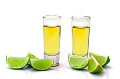 Shot of Gold Tequila with Slice Lime Royalty Free Stock Photos