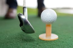 Shot golf ball with golf club stock image