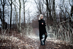 Shot of a gothic woman in a forest. Royalty Free Stock Image