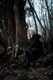 Shot of a gothic woman in a forest. Fashion Stock Photography
