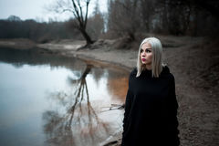 Shot of a gothic woman in a forest. Fashion Stock Image
