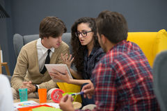 Shot of a group of young business professionals having a meeting. Diverse group of young designers smiling during a meeting at the office Royalty Free Stock Photo
