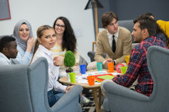 Shot of a group of young business professionals having a meeting. Stock Image