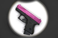 Shot gun black color grip part and pink chrome slide barrel,use. 9 mm ammunition with magazine grip accessory stock photos