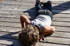 Shot by a gun. Kid plays that he had been shot by a guy Royalty Free Stock Photos