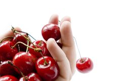 Shot of handful of red cherries on white. A handful of red cherries on white background Stock Photos