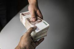 Shot of handover money stack. Royalty Free Stock Photo