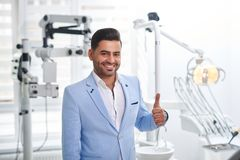 Young man visiting dentist royalty free stock photography