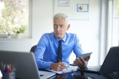 Executive businessman working in the office stock photo