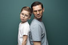 Shot of handsome caucasian father and son wearing stylish eyeglasses stock image