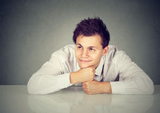 Shot of a handsome man looking thoughtful and happy royalty free stock image