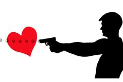 Shot through the heart. Man shooting bubbles with a 40 caliber pistol thru a red heart Royalty Free Stock Photo