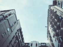 A shot of a high-rise building from the bottom up against the sky.  stock images