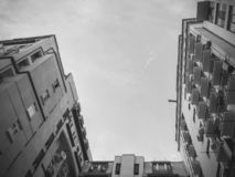 A shot of a high-rise building from the bottom up against the sky.  stock photography