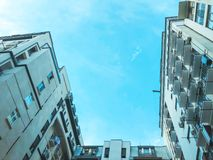 A shot of a high-rise building from the bottom up against the sky.  stock image