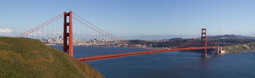 A panorama of the Golden Gate Bridge in the afternoon on a nearly cloudless day. Shot from a hillside not far away, the photo is cropped to exaggerate the length Royalty Free Stock Photos