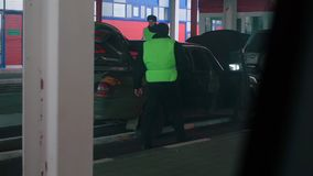 Cars getting repaired. A shot inside a automotive repair shop stock footage